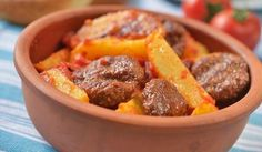 Turkish meatball kofte with potato under tomato sauce Selective focus Turkish Recipes, Greek Recipes, Ethnic Recipes, Turkish Meatballs, Egyptian Food, Arabic Food, Meatball Recipes, Different Recipes, Tomato Sauce