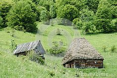 Photo about A traditional wooden barn with straw thatched roof on a hill side in Transylvania. Image of vegetation, nature, natural - 54896865 Wooden Barn, Thatched Roof, Cabin, Stock Photos, Traditional, House Styles, Nature, Image, Naturaleza