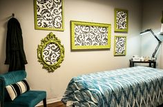 Graphic wallpaper in fun frames eat up the wall space in this spa.
