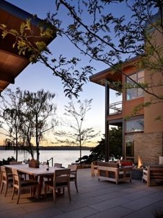 Wow, I would love a set up like this! A patio overlooking the water AND a fire pit. Yes please :]