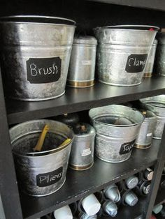 Sewing craft room ideas with galvanized buckets and chalkboard paint