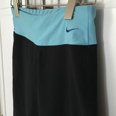 """Cropped Nike Yoga Pants Black xs Cute Nike fit dry / Dri Fit black and turquoise cropped yoga athletic pants. Good condition. Rise: 8"""". Inseam: 22"""" Nike Pants Track Pants & Joggers"""
