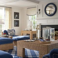 This living room's twist on classic New England seaside themes (wicker, blue and white, nautical touches) feels modern yet welcoming. Crisp hues rejuvenate the traditional seaside color palette by contrasting against dark wicker wood, while giant stripes, oversize checks, enlarged prints, and teensy dots look strikingly modern.