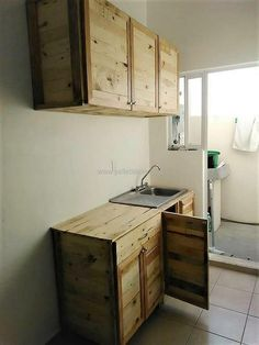we would like to show you the overall look of the repurposed wood pallet because it will help you in deciding whether you should copy this idea or not. There is no need to spend money on the paint for this idea and this is an inexpensive idea for creating kitchen cabinets.