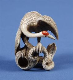 JAPANESE IVORY NETSUKE - Katabori ivory netsuke of crane on an overturned basket fighting a snake