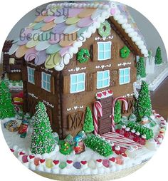 Gingerbread Cottage with Necco roof tiles!!! Bebe'!!! Love this beautiful elaborate cottage!!!