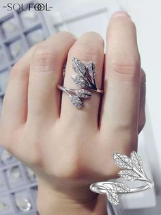 Such a beautiful and elegant design of this leaf shaped ring! And all the Swarovski crystal make it gorgeous and pure! Love it.