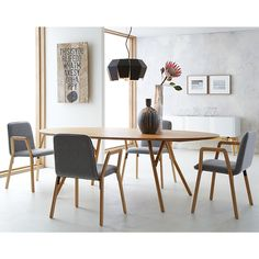 Love this room by CB2. So light and airy, but you can seat 6 at this table. Love table so much. With this table you can use traditional dining chairs or modern chairs. Modern with traditional shows imagination and is not matchy matchy. Biddy Craft