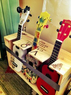 I found a new use for a wine box. My new ukulele stand.
