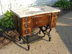 Craigslist- awesome bathroom sink/vanity - made out of a treadle sewing machine cabinet!