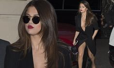 Selena Gomez shows off cleavage in extreme plunging dress in Paris