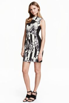 Patterned dress: Fitted, sleeveless knee-length dress in a patterned weave with a high neckline and a visible zip and short slit at the back. Unlined.