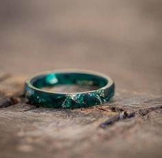 This very thin skinny faceted deep teal stacking ring is made from high quality bio-based eco-friendly resin. The ring contains sparkled yellow imitation gold flakes. This resin ring is perfect for stacking. My resin jewellery is cast in handmade by me silicone molds, hand sanded and hand