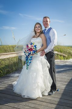 The bridge area on the side of the Grand Plaza, is the best area when the sun is still very bright.  Provides good contrast for wedding Photography. http://celebrationsoftampabay.com/photographers-st-pete-beach/
