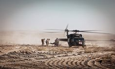 Petty Officer 3rd Class Michael Soto accompanies litter-bearers as they load an injured Marine into a UH-60 Black Hawk helicopter during a medical evacuation in Garmsir, in Afghanistan's Helmand province - #Marines