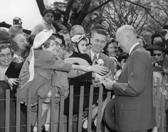 President Dwight D. Eisenhower Greets the Crowd who have come for the Easter Egg Roll on the South Lawn of the White House, April 2,1956.  Series: Numerical Photographs, 1962 - ca. 1979. Collection: Still Photograph Collection, 1962 - 2004 (Holdings of the Eisenhower Presidential Library and Museum) https://catalog.archives.gov/id/16915737