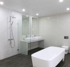 WOW! Alpine Mist wall panels have us gushing over this unique bathroom by JD Bathroomware & Tiles. #Caesarstone #interiordesign #quartz #bath #masterbath #kitchen #modernhome