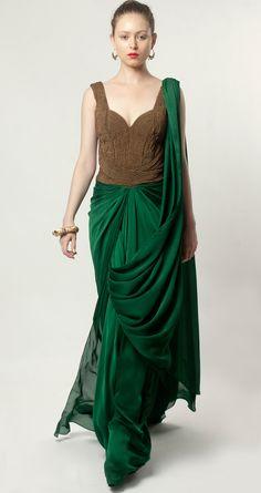 Emerald green pre-draped sari by AMIT AGGARWAL. Shop at http://www.perniaspopupshop.com/lakme-fashion-week/amit-aggarwal/amit-aggarwal-emerald-green-pre-draped-sari-aalfw0813sa39.html
