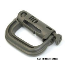 Fastex® Grimloc™ Locking D-Ring Carabiner. Made of a high strength, lightweight plastic that is resistant to rusting, corrosion, solar heating and IR detection. Works with MOLLE/PALS webbing and is good for attaching weapons, accessories, or anything you need.
