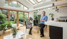 Extra space: Mikko and Joanna in the vast kitchen-living room on the extended ground floor Council House Makeover, Council House Renovation, Home Renovation, Bungalow Extensions, House Extensions, Engineered Oak Flooring, Under Stairs Cupboard, Attic Spaces, Attic Rooms