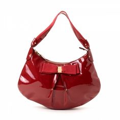 ed8640de67ec LXRandCo guarantees this is an authentic vintage Ferragamo Vara Bow Hobo Bag  shoulder bag. This classic bag was crafted in patent leather in red.