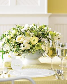 creamy arrangement of lilacs, garden roses, jasmine, fritillaria, and pale-green hellebores