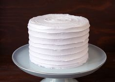 Buttercream cake with frosted horizontal lines that give a ribbon or wave look