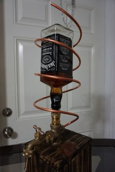 Custom Made Whiskey/liquor dispenser. Will accept most liquor bottles with the standard opening as long as it does not have the integrated pour spout.