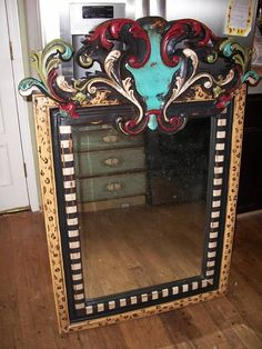 A WHOLE LOTTA WOW MIRROR... 1.) Buy mirror @ Goodwill.  2.) Strip, sand, prime.  3.) Add decorative trim (local hardware or craft store) using wood glue.  4,) Paint with love.  5.) Minwax (minimum 3 coats, waiting at least 2 hours in between).  6.)  Hang with love.