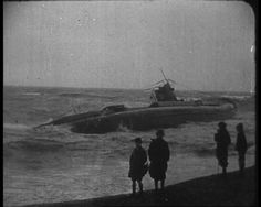 A U-boat is driven ashore by gales in 1919. Hastings, England. Click here to view the newsreel: http://www.britishpathe.com/video/another-u-boat