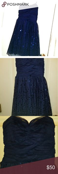 Navy Blue Party Dress Size 0 short strapless navy blue party dress Boning on the sides Only worn once! Perfect for homecoming or any semi formal event Willing to negotiate price Delia's Dresses Strapless