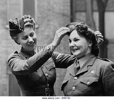 Stock Photo - Members of the ATS adjust their caps before a parade. Women In History, British History, Just Like Fire, Battle Dress, Ww2 Uniforms, Home Guard, Victorian Photos, Short Waves, War Photography