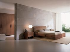 Bedroom uses limited color to create a tranquil space.