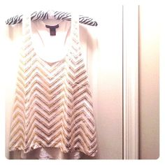 FINAL PRICE ☺️ Gold & White Top Never worn & in excellent, perfect condition! (Too big for my liking.) I think it's high in the front and the back part is longer, based on the first picture. I tried to model it. The faded golden chevron is the original style. Solid white in the back. Material Girl Tops