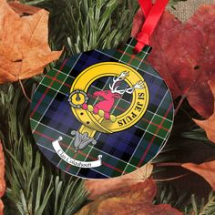 Aluminium ornament with printed clan crest and tartan - several shapes available. Ornament is printed with clan crest and tartan on one side and tartan on reverse. Choose from Bauble, Tree, Star, Heart, and Gingerbread Man. Printed in Edinburgh, Scotland.