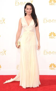 Lucy Liu from 2014 Emmys: Red Carpet Arrivals...Wait this has some interesting details. Try different fabric combination & embellishments for that bridal look. Work with your seamstress to achieve this look for that ultimate bridal look.