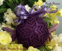 Purple Passion Quilted Ornament   The Butterfly Collection  This 3 inch ornament is layered in the Star pattern with a deep purple satin ribbon. The top is embellished with shear purple ribbon. The sides of this ornament has two crystal purple butterflies on each side. This ornaments comes gift boxed. Price: $25.00