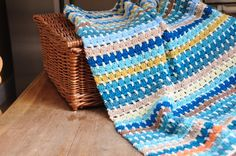 FREE PATTERN FROM HANJAN CROCHET!This blanket really is a classic that anyone can tackle. All you need is a bunch of your favourite yarn colours - as many or as few as you like - and you're away. Using a simple pattern repeat this is the perfect beginner project to practise your tension and technique. The series will include blankets made with approximately 250g of double knit yarn using a 5mm/H hook. The free download pattern has links to my blog for more hints and tips too.So wheth...