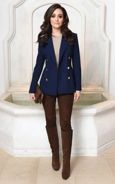 Emmy Rossum in a navy blazer, brown riding pants and brown knee-high boots - click through to see more celebrity winter outfits