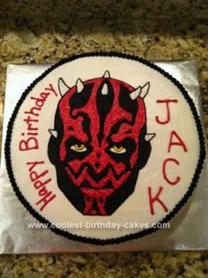 Homemade Darth Maul Cake: This Darth Maul Cake was for my son's 5th birthday party. I found a picture of Darth Maul online, printed it and used an opaque projector to enlarge it.