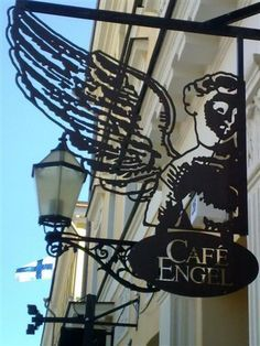 *Enseigne, Café Engel by the Senate Square, Helsinki. Blade Sign, Sign O' The Times, Storefront Signs, Different Signs, Pub Signs, My Coffee, Coffee Shops, White Lilies, Street Lamp