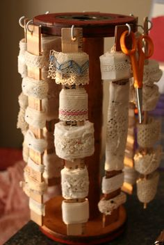 A large wooden spool - cup hooks - rulers wrapped with bits of lace