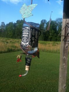 Jack Daniels bottle as hummingbird feeder