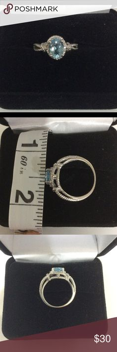 Sterling Silver Aquamarine Ring Beautiful rope design aquamarine color stone, a tiny white stone on each side of center stone. Please note that the ring is not in a polished condition. See 4th picture of white stone. Silver .925, March birth stone. ❤️ sterling silver Jewelry Rings