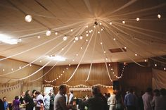 Hide an ugly ceiling - draped lights and ribbon
