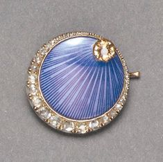 A FABERGE GOLD, BLUE GUILLOCHE ENAMEL AND JEWELED BROOCH, WORKMASTER OSKAR PIHL, MOSCOW, CIRCA 1890