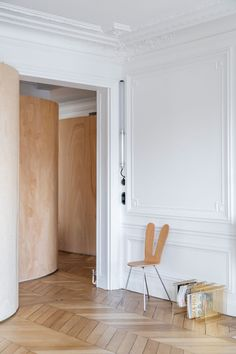 "The young family asked Toledano + Architects to inject new life into a typical Haussmanien Parisian apartment. ""This apartment is a typical Haussmanien Plywood Interior, Plywood Walls, Timber Walls, Plywood House, Wooden Partitions, Ribbon Wall, Decoracion Vintage Chic, Cabinet D Architecture, Contemporary Light Fixtures"