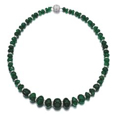 Emerald and diamond necklace Designed as a graduated row of polished emerald beads, with brilliant-cut diamond spacers and clasp, length approximately 395mm.