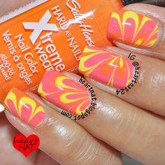 Yellow, Orange, and Pink Watermarble nail art that looks like flowers. #nailart #nails #nailpolish