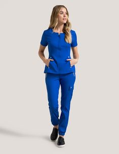 Hidden Zipper Top in Black is a contemporary addition to women's medical scrub outfits. Shop Jaanuu for scrubs, lab coats and other medical apparel. Scrubs Outfit, Scrubs Uniform, Royal Blue Scrubs, Stylish Scrubs, Beauty Uniforms, Cute Scrubs, Lab Coats, Medical Uniforms, Medical Scrubs